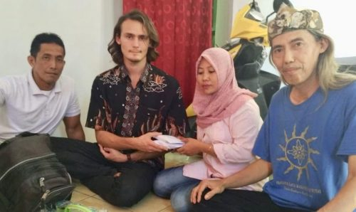 Ben Presenting Money To Widow In Cirebon Crop